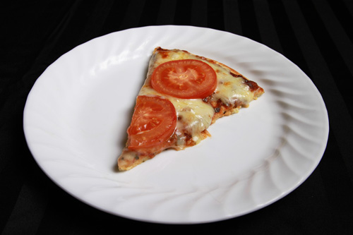 Herbed Gluten Free Coconut Flour Pizza Crust pizza slice with toppings recipe photo